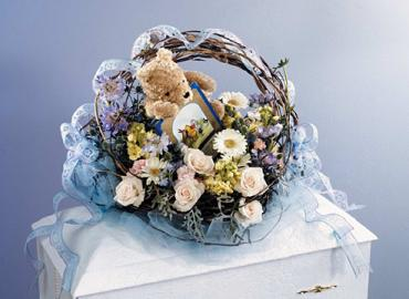 Blue and Ivory Basket Casket Spray