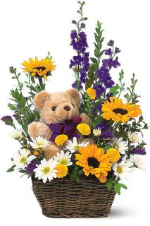Teddy Bear In Basket With Flowers