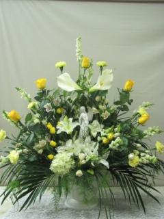 SYMPATHY ARRANGEMENT WITH YELLOW ROSES